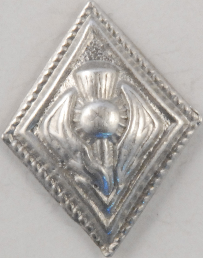 dimond shaped Pewter button with thisel
