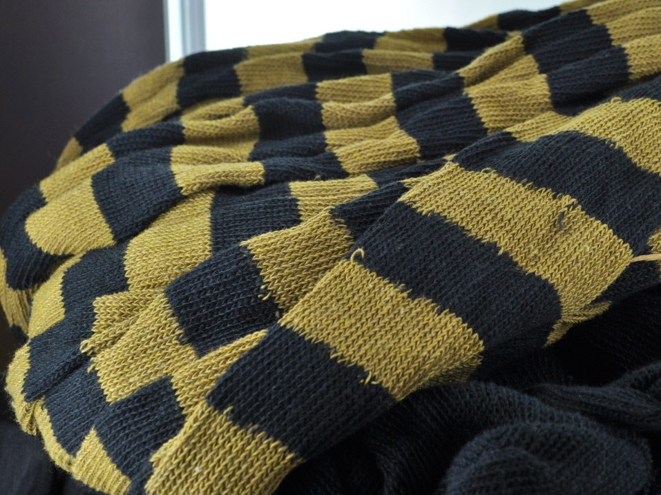 over the knee stocking black and gold
