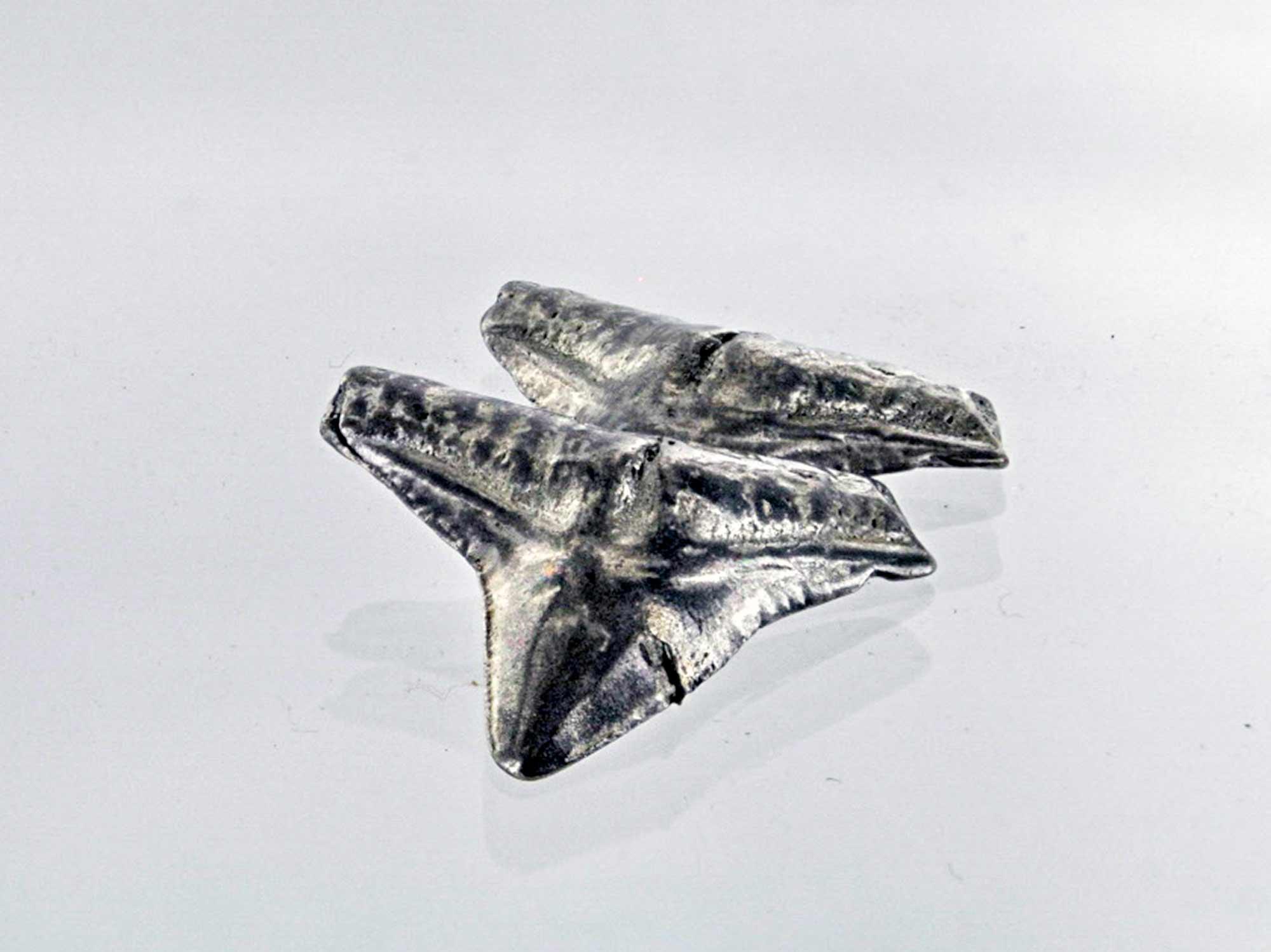 Cast pewter shark teeth